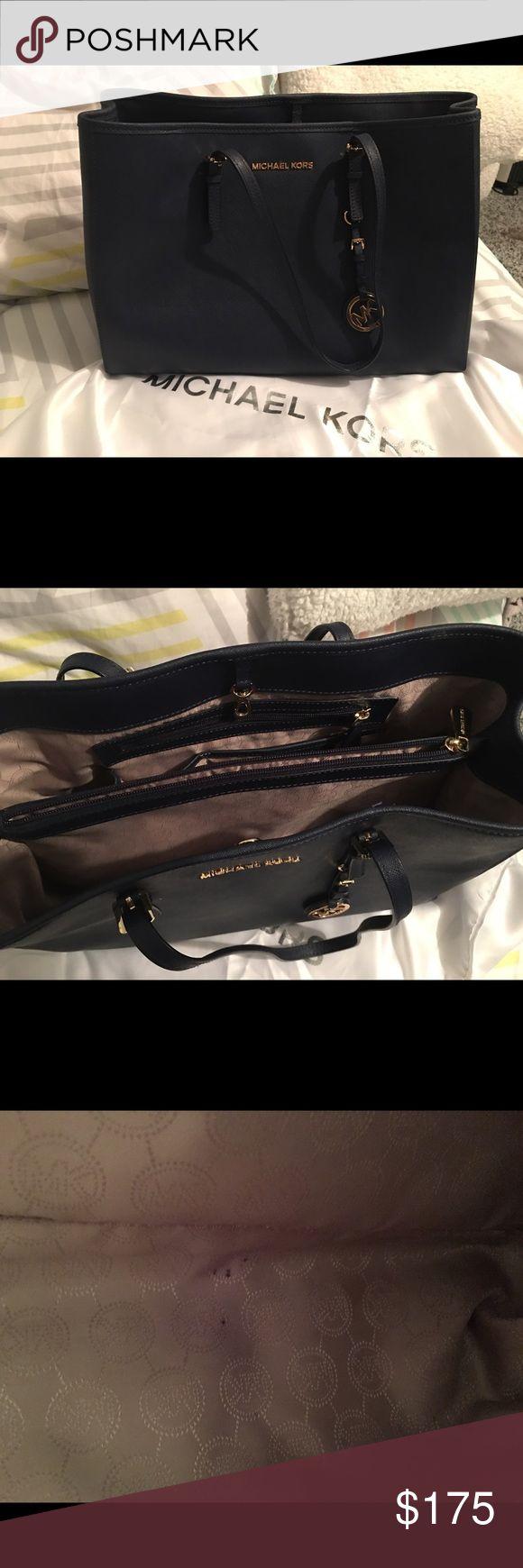 Michael Kors purse Dark navy blue Michael Kors bag gold hardware. As seen in pic 3 very microscopic pen stains. Michael Kors Bags Satchels