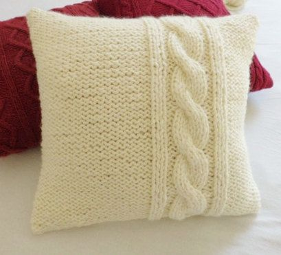 I knitted this pillow cover using a thick and soft chunky ivory yarn with a cable stitch design on the side at front and back as well. The cushion