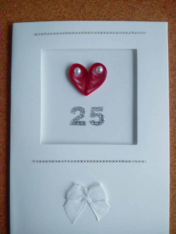I wanted a clean cut, simple card for some friends' Silver Wedding Anniversary. I filled the envelope with 25 mini die-cut hearts as confetti
