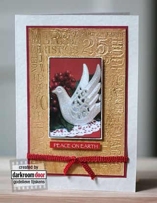 Stamping into Gesso using Darkroom Door Christmas Word Block Stamp and colouring with Viva Decor Inka Gold. Card by Godelieve Tijskens.