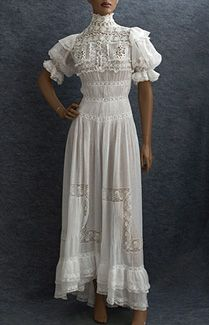 Edwardian tea dress: Dotted Swiss/lace tea dress, c.1905. Elaborately embellished with lace, embroidered cut work, ruffles, and narrow tucks, the dress is a welcome relief from the strapless designs seen everywhere today. The delightful puffed sleeves have inner cords to hold them in place. The skirt is longer and fuller in back, forming a small train. The soft feminine style and delicious detail will appeal to your inner princess. 800$