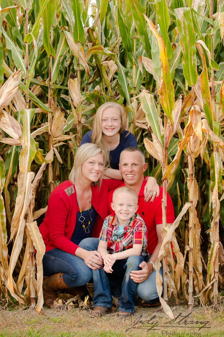 Country family in their corn field.