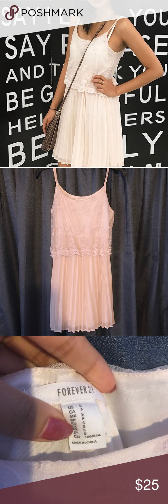 Vintage inspired lace dress Gorgeous dress for a summer night out on the town. Worn only a few times, has adjustable shoulder straps, and stops mid thigh. It is also an off white color. Forever 21 Dresses Midi