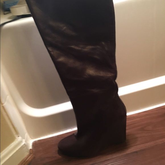 Nine West Brown Wedge Boots Nine West Brown Wedge Boots, leather upper, slightly worn, very comfortable. For a slim leg. Nine West Shoes Heeled Boots