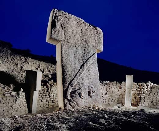 Gobekli Tepe, Turkey: massive carved stones about 11,000 years old, crafted and arranged by prehistoric people who had not yet developed metal tools or even pottery. The megaliths predate Stonehenge by some 6,000 years.    Read more: http://www.smithsonianmag.com/history-archaeology/gobekli-tepe.html#ixzz1lTLidVke