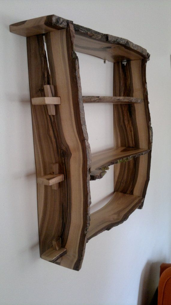 Walnut wood shelves. Natural edge wall-mounted, handmade from bookmatched planks of English 'Blackheart'