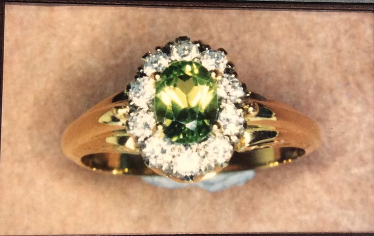 Peridot and diamond gallery cluster ring with a wide contoured band