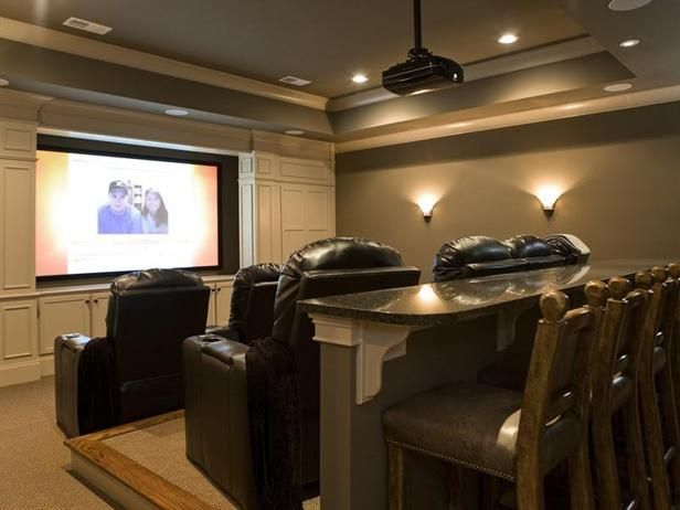 Home Theater: cool idea with the bar stools as the third row of seats.  Would be good for eating nachos there while watching a game.