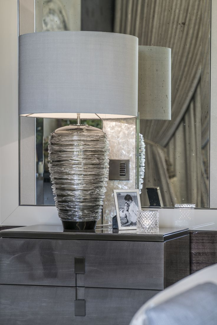 This ethereal Thread Lamp in charcoal by @portaromanauk is made from delicate glass threading wrapped around a blown and moulded glass body, adding another layer of finesse to our elegant master bedroom design.