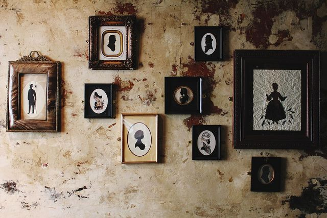 Love the idea of using a doily as a mat.    vintage silhouette frames by Anamu, via Flickr