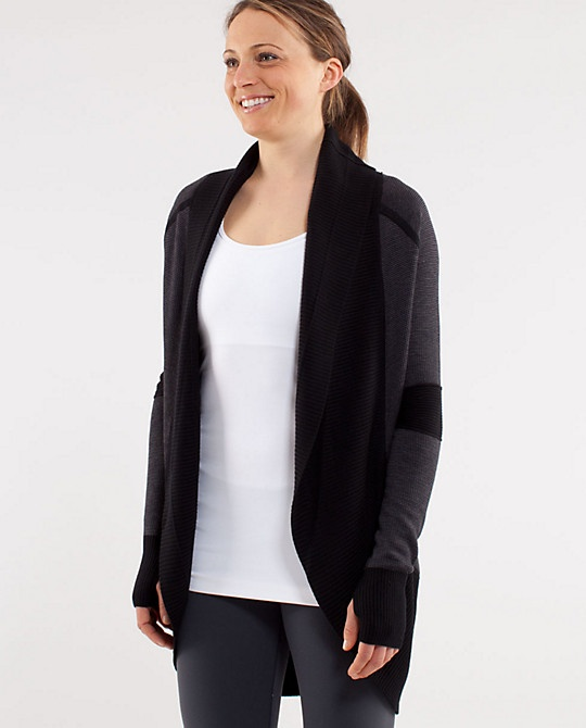 Transformational Sweater from Lululemon. I own this. It's reversible and has a cinch to change length. Like all things Lulu I wear it too much. :)