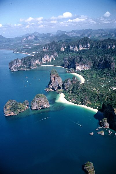 How to get from Krabi town to Ao Nang and Railay beach:: Distance from Krabi to Ao Nang is around 18km and it takes about 20 minutes by taxi (400-500B one way). Or you can get the local form of transport, a songthaew, which stops to pick up and drop off customers. It costs about 60B and takes about 45 minutes. From Ao Nang, Railay bay is only a 15 minute 100 baht boat ride away.