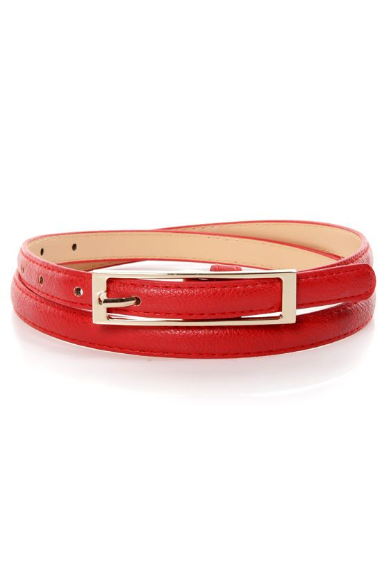 "Belt it like the diva that you are with the brand new Belt It Out Red Skinny Belt! Fabulous red vegan leather with tonal top-stitching has a shiny gold rectangular buckle with seven hole adjustments. Belt measures 41"" long, just over 1/2"" wide, and 30"" around at smallest adjustment. Man made materials."