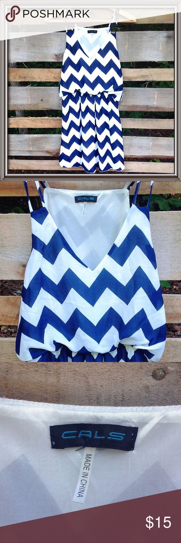 "CALS dress with Chevron Print This adorable blue & white Chevron Print Dress has an elastic waist and is lined.  There is no size tag, but I know it is a small.  It was my daughter's dress 100% polyester  Approximate measurements are - 16.5"" bust and 33"" long  It is in VERY good condition!! CALS Dresses"