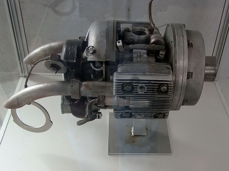 "One interesting feature of the 004 was the starter system, designed by the German engineer Norbert Riedel, consisting of a 10 hp (7.5 kW) 2-stroke flat engine hidden in the intake, essentially functioning as a pioneering example of an APU for jet engine starting. A hole in the extreme nose of the intake diverter body contained a pull-handle for the cable which ""turned-over"" the piston engine, which in turn spun up the turbine."