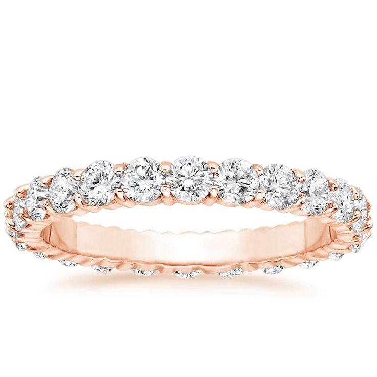 This eye-catching eternity band encircles the finger with shimmering diamonds set in beautifully sculpted shared prongs (1.20 to 1.50 total carat weight).