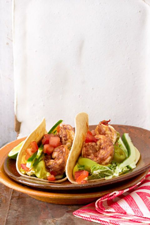 These shrimp tacos save 444 calories and 45 grams of fat per serving, compared with typical beef tacos in flour tortillas with guacamole, sour cream, and Cheddar.  Get the recipe.
