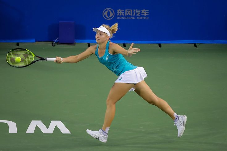 Daria Gavrilova Photos - Daria Gavrilova of Australia returns a shot during the match against Julia Goerges of Germany on Day 2 of 2017 Dongfeng Motor Wuhan Open at Optics Valley International Tennis Center on September 25, 2017 in Wuhan, China. - 2017 Wuhan Open - Day 2