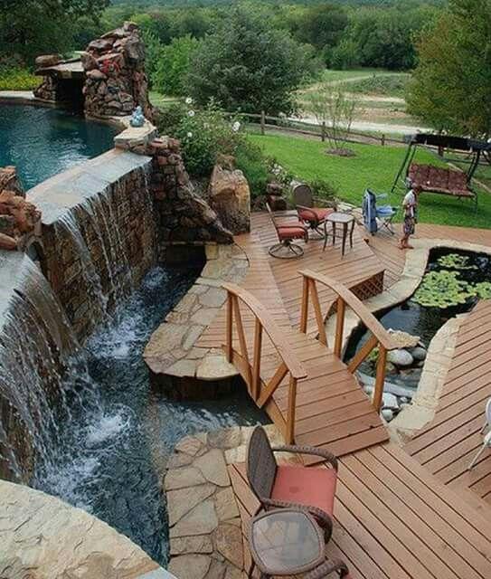 Pool, Waterfall, Bridge, Pond, And Deck.