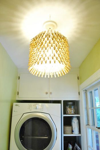 Cute laundry room chandelier idea using clothespins.