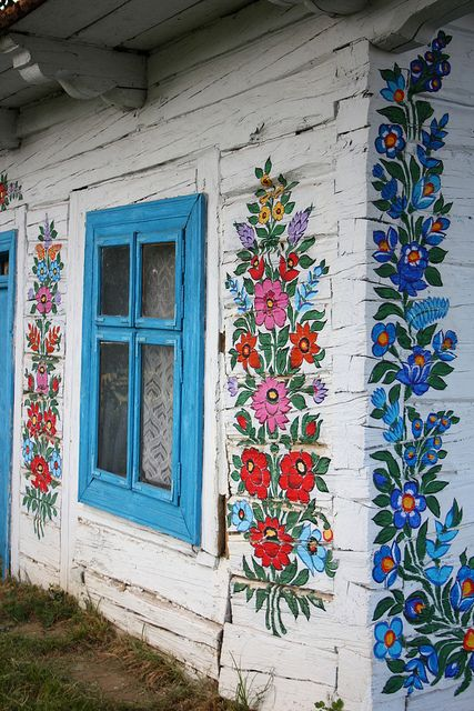Zalipie is a village in Poland where all the houses are painted with flowers. I would love to live in a house like that!