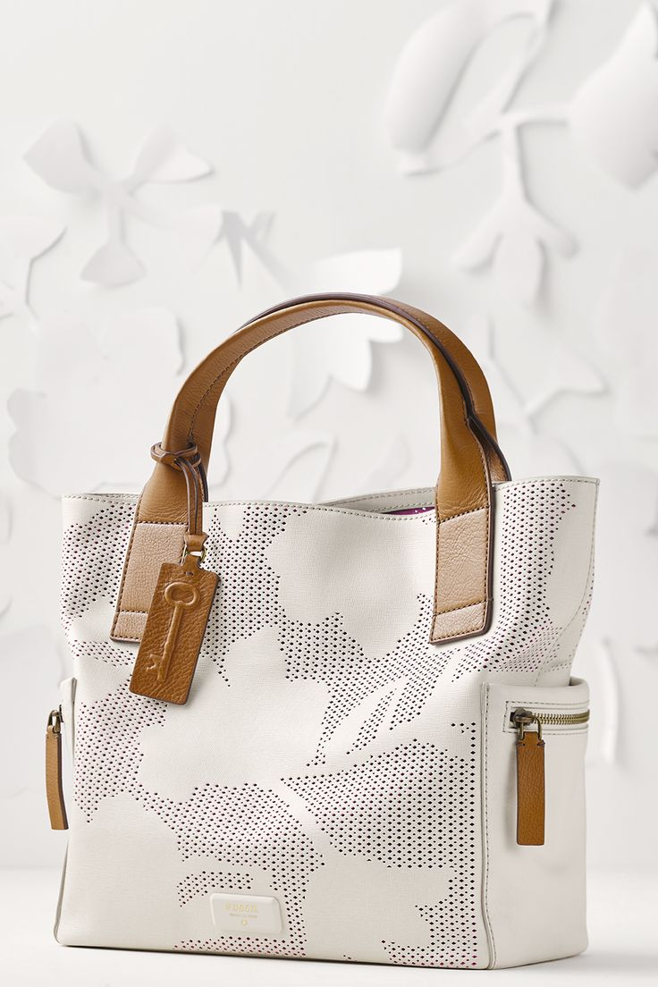 Pretty in floral, we think this Emerson Satchel handbag with floral perforated​ leather makes the ultimate Mother's Day gift.