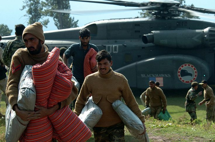 Pakistani Soldiers unload humanitarian relief supplies