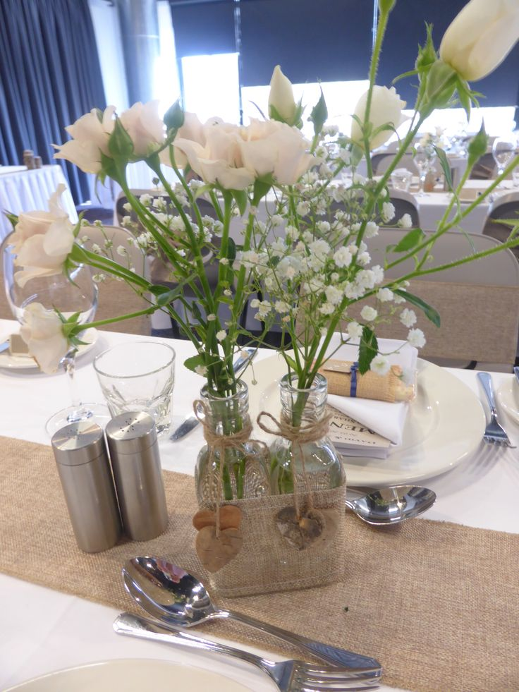 Love roses and baby's breath.  Love the effect with burlap touches.