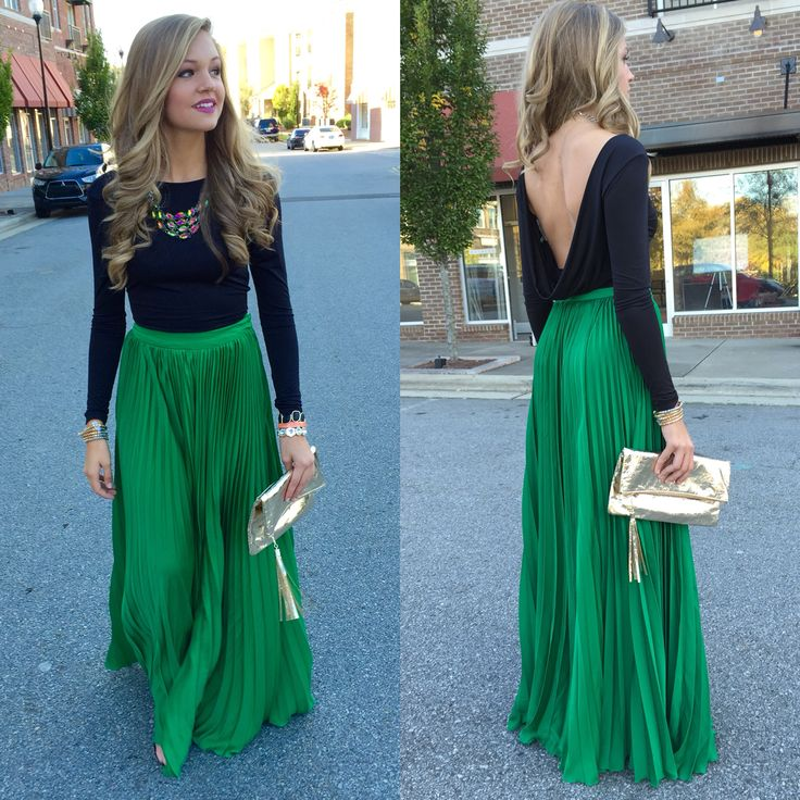 Green pleated maxi skirt with long sleeved backless top.