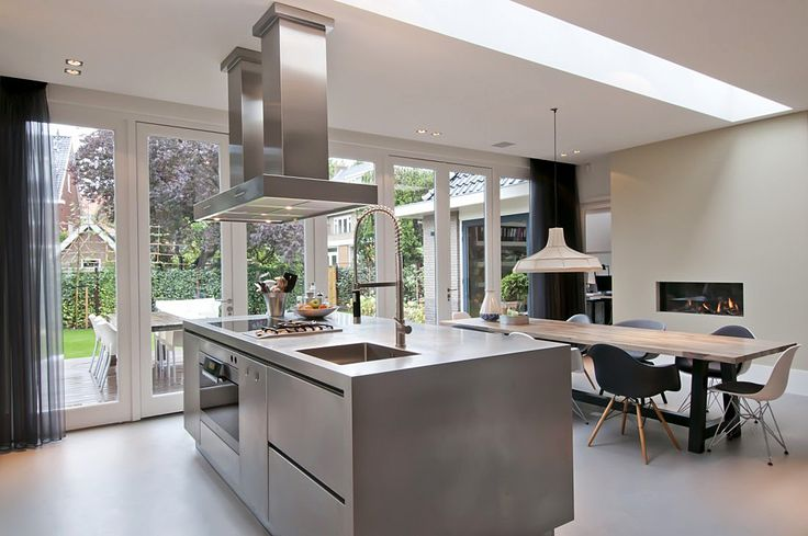 kitchen and dining in a rear extension with long rooflight and fab fire