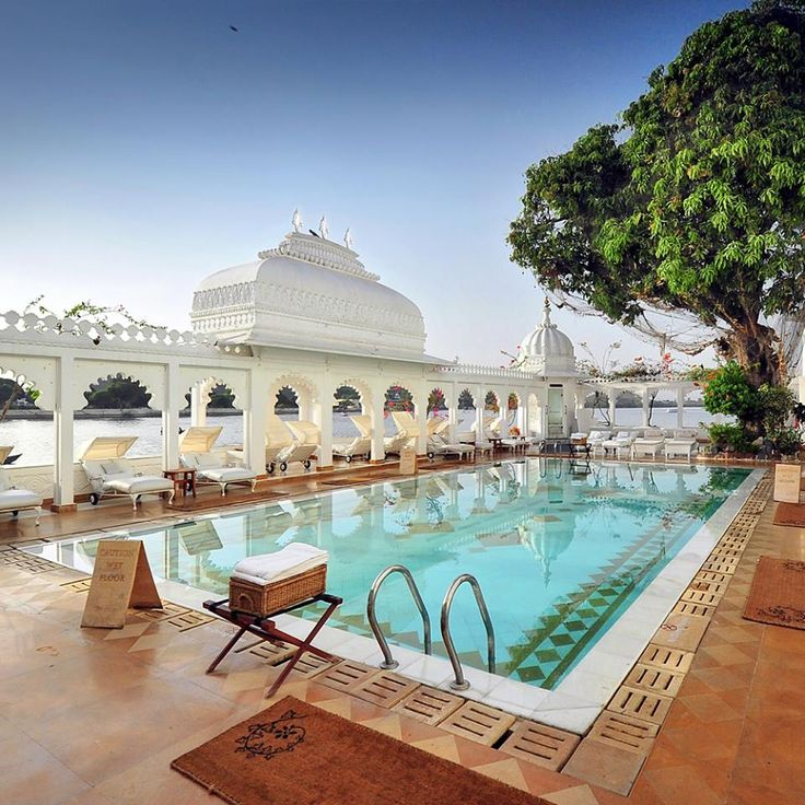 """he lovely swimming pool at the Taj Lake Palace in Udaipur, India. Check out review from our stay at this island hotel: http://www.travelplusstyle.com/hotels/taj-lake-palace-udaipur  From our review: """"As mist lifts from the quiet water, the white walls and domes of the Taj hotel rise from the middle of the Lake Pichola as if they were part of a fleeting dream. It could just as well be a dream—but the Taj Lake Palace is real. And it really is a palace.""""  Photo and text © Travel+Style"""
