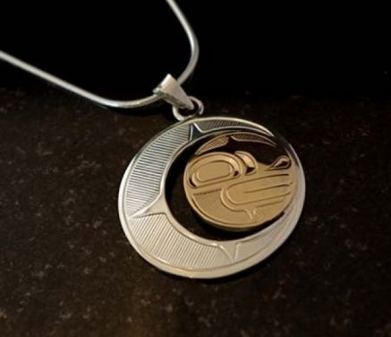 This sleek and completely unique pendant is hand-carved and measures 1 1/2 inches in diameter. This pendant makes a great gift that really epitomizes the West Coast. The Moon is a symbol associated with protection and maternal qualities...counterpoint to the Sun. $345. By Justin Rivard.