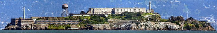 A panorama of Alcatraz as viewed from San Francisco Bay, facing east. Sather Tower and UC Berkeley are visible in the background on the right.