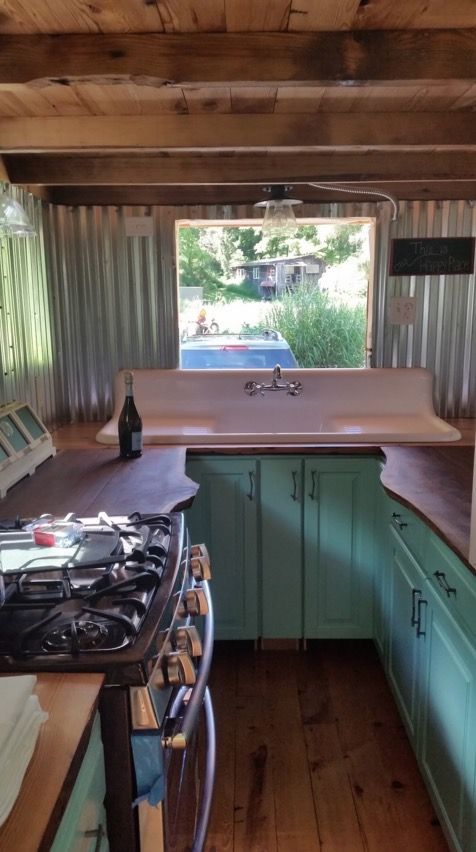 couple with two dogs and one cat living in a tiny house 003 - Tiny House Kitchen 2