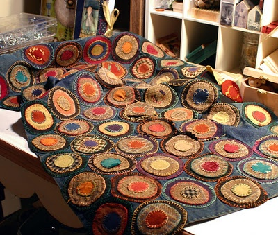 Beautiful antique penny rug