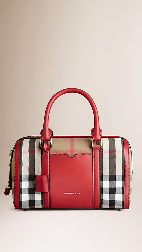 Burberry Military Red The Medium Alchester in House Check and Leather - A structured bowling bag in House check with a sartorial leather front pocket. The bag features hand-stitched rolled leather handles, a zip top closure with oversize leather pulls and detachable shoulder strap. Inspired by heritage travel designs, the bag is finished with hand-painted edges, a polished metal luggage lock and leather key holder. Discover the women's bags collection at Burberry.com