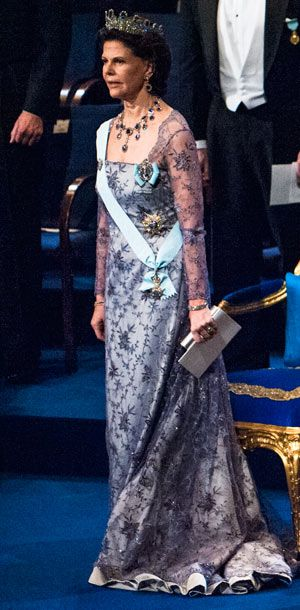 Queen Silvia of Sweden at the 2012 Nobel Prize Award Ceremony in a lilac dress in lace with pearl and sequin embroidery, the Leuchtenberg Sa...
