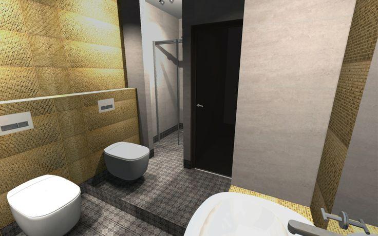 Małe wc, powiększone zostało o wnękę, w którą wkomponowano prysznic. Zastosowana kolorystyka to połaczenie modnych szarości oraz płytki w złotym kolorze o strukturze drobnej połyskującej mozaiki.