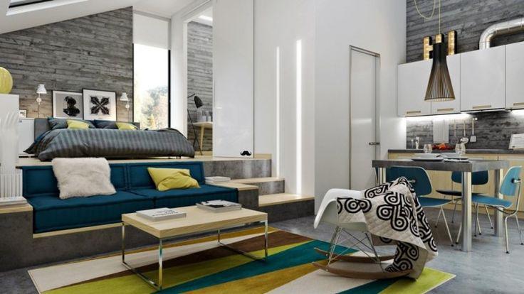 béton ciré sol, parement mural en brique grise, table basse en bois, canapé en bois et tapis graphique