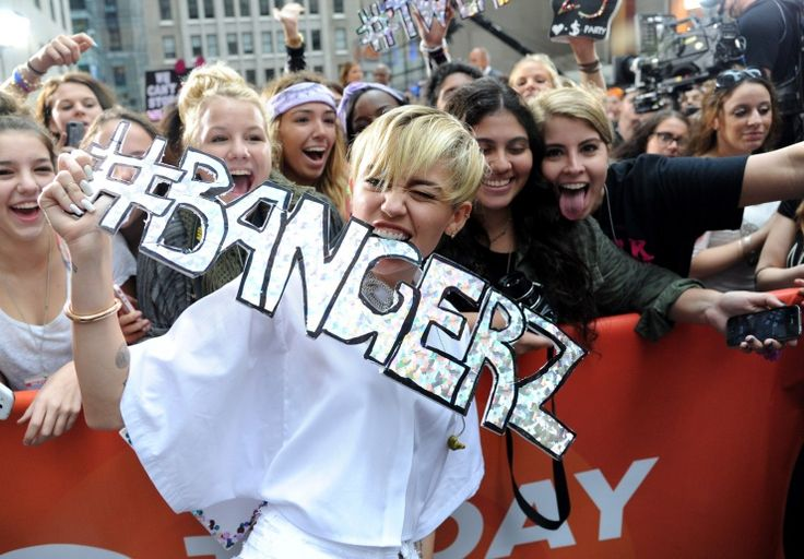 "Miley Cyrus bites a mouthful of Bangerz during her appearance on the ""Today"" show on Oct. 7 in New York: Music, Miley Cyrus, Cyrus Bites, Oct, New York, Celeb Singer"