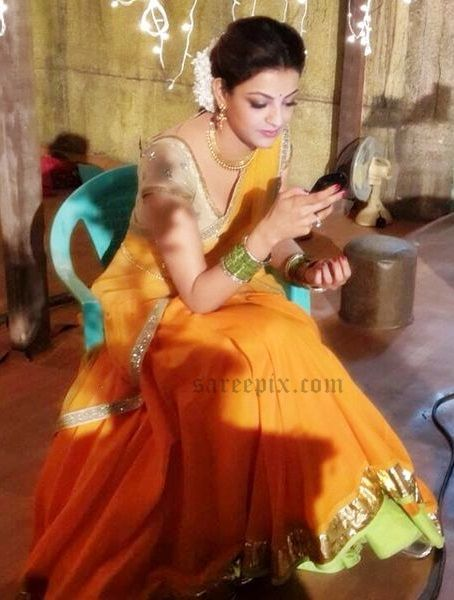 This yellow half saree is trendy and traditional. Kajal Agarwal