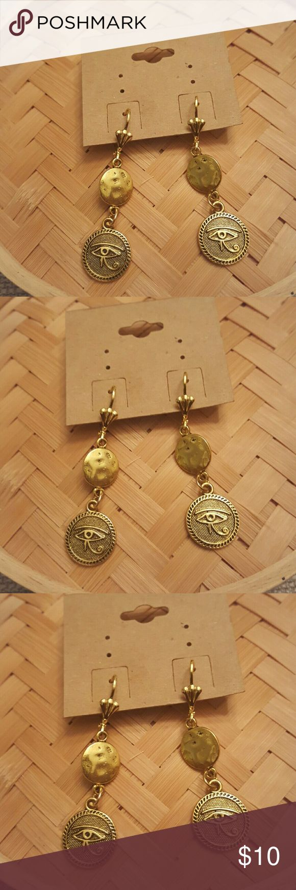Ancient Egypt Eye of Ra gold charms earrings Ancient Egypt Eye of Ra  gold pewter charms Dangle earrings. Hypoallergenic gold lever backs ear wires.  Light weight. Jewelry Earrings
