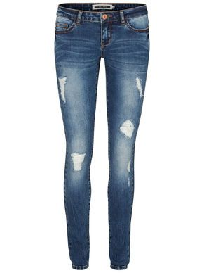 Ripped blue jeans styled with blue oversized shirt