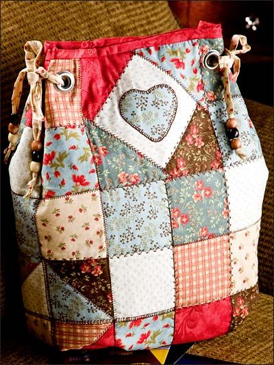 Patchwork bag with eyelet closures.