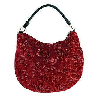 This striking new bucket bag features a stylish leather handle and is made from luxurious velvet.