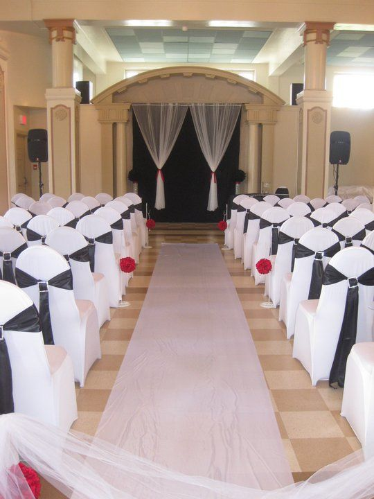 White Stretch Chair Covers with Black Satin Sashes & rhinestone buckle Red Kissing Ball Aisle Décor B&W Backdrop/Altar Heritage Hall Vancouver
