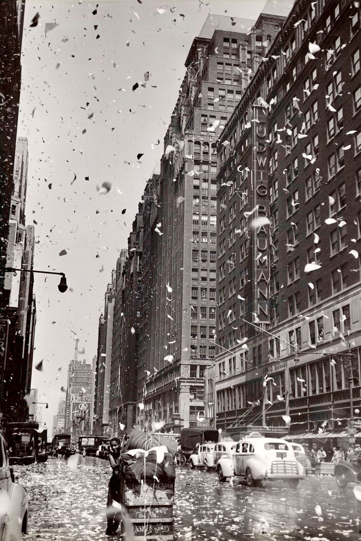 """This Aug. 10, 1945 photo titled """"Celebration in the Garment District on Japanese offer to surrender"""" by crime photographer Weegee, whose real name was Arthur Fellig, was provided by the International Center of Photography in New York."""