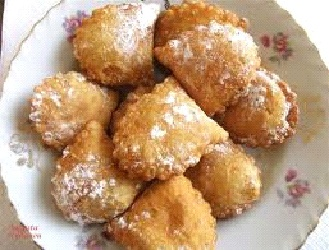 Bourekia is a sweet fried pastry made with a thin flaky phyllo, and filled with anari cheese.