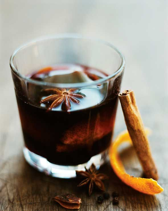 Hot Spiced Wine Recipe (Your mother-in-law may frown upon you teetering around, a martini sloshing in your glass, slurring your word every second of every family function during the holidays. But strolling about with a glass of this genteel hot spiced wine? Sooooo much more socially acceptable.)