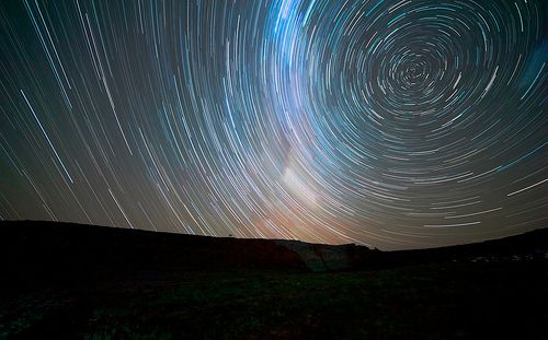 """10 Useful Tips for Photographing Beautiful Star Trails: """"When post-processing star-trails start with noise reduction, then adjust contrast and saturation and finally sharpen to taste. Removing noise is the most important step, then its just about your taste."""""""